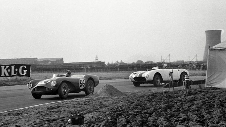 Phil Collins leads in DBS3/2 at Aintree ahead of Masten Gregory in a Ferrari 375 MM.