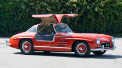 redMercedes-Benz 300 SL Gullwing doors open on offer in the Gooding Geared Online 2020 sale