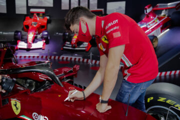 Charles Leclerc signing the Ferrari SF1000 Show Car