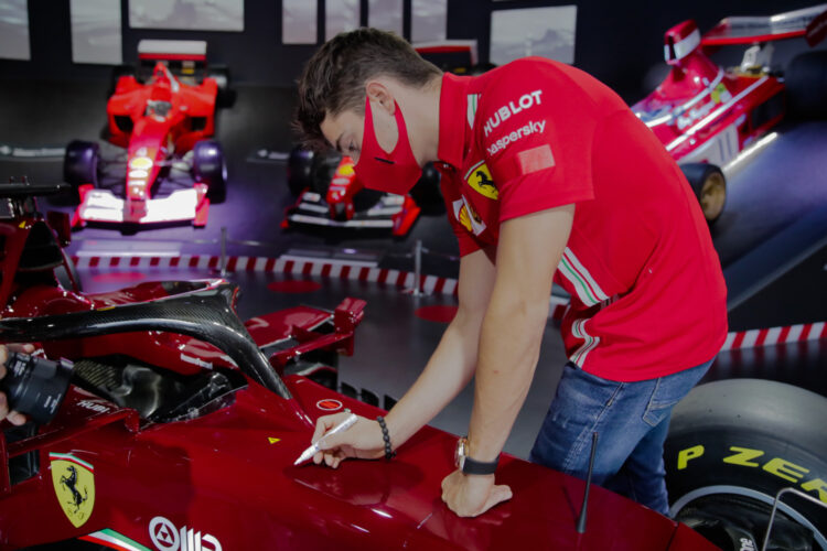 Charles Leclerc signing the Ferrari SF1000 Show Car