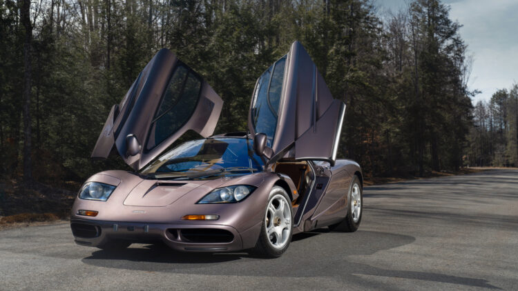 open doors 1995 McLaren F1 -- Most expensive McLaren ever sold in a public auction topping the results at Monterey 2021